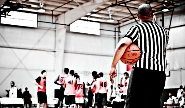 Referee with basketball Elite Preview